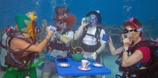 Underwater Music Festival participants Katie Jennele, Bob Rowland, Eric Rolfe and Alicia Merel, enjoy an 'Alice in Wonderland' tea party. AP Photo/Florida Keys News Bureau, Bob Care.
