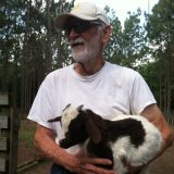 Mr. Golden himself shows off one of his Myotonic Tennessee fainting goats.
