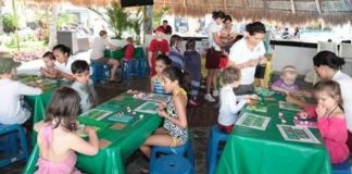 Children participate in cultural crafts at the Mini Mayans program at Azul Hotels by Karisma.