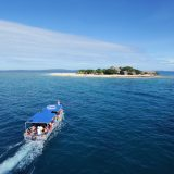 A cruise boat from Port Denarau approaches South Sea Island off the coast of Denarau Island in Fiji.
