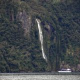 Waterfalls add a pleasant, awesome contrast to the barrenness of Milford Sound.