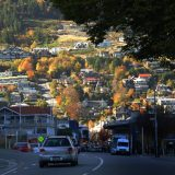 Queenstown, New Zealand, lies splashed against colorful and steep lakeside hills.