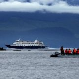 Passengers return to Safari Endeavour after an onshore outing near Ford's Terror, an inlet of Alaska's Glacier National Park.