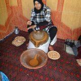 Berber woman making argan oil