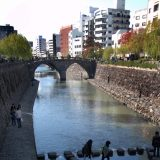 Nagasaki is a city of canals and rivers. This 17th century Sukuro Bridge over the Nakashima River is a city landmark. People often use the stones in the foreground to cross the river.