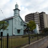 Built in the 17th century, a Dutch church stands in contrast to Nagasaki's modern buildings. The church is on Dejima Island, where Dutch traders were confined by the xenophobic lords that ruled Japan at the time.