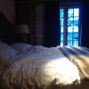 A bedroom at Chalet Perelin located near the living room.