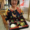 Emi Kinjo with a bento box of healthy dishes served in Emi-no-mise. Her restaurant in Ogimi Village is reputed as the place with the highest longevity index in the world.