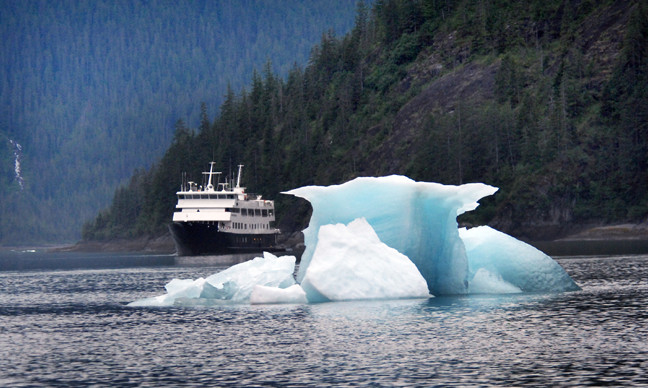 Iceberg and cruise ship. Inside Passage, Alaska.