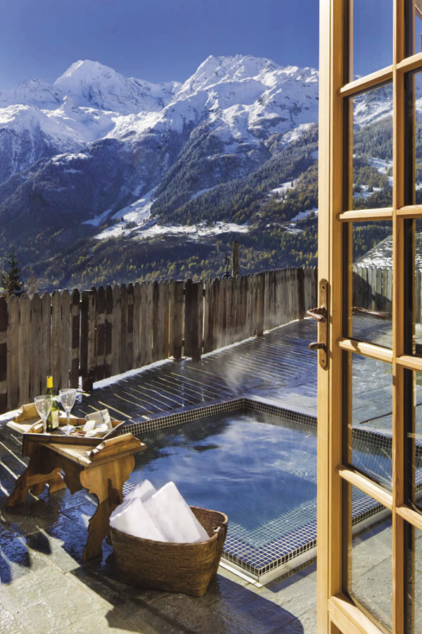 Guests of the chalet can opt to take a dip in the outdoor hot tub