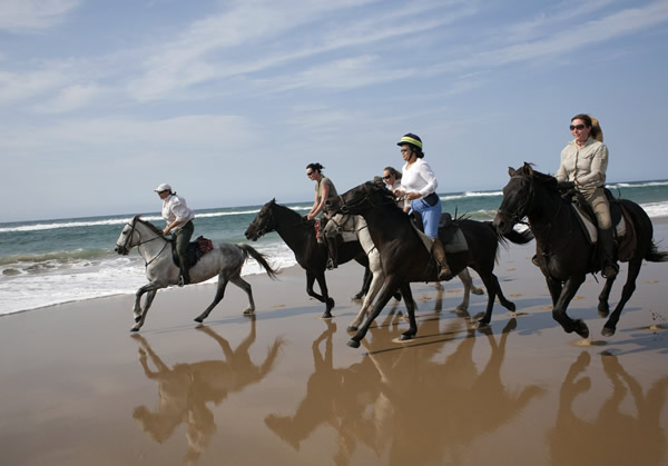 Horseback riding along South Africa's shorelines is one of the many off-the-beaten-path activities.