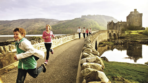 Adventures by Disney guests visit Eilean Donan Castle.