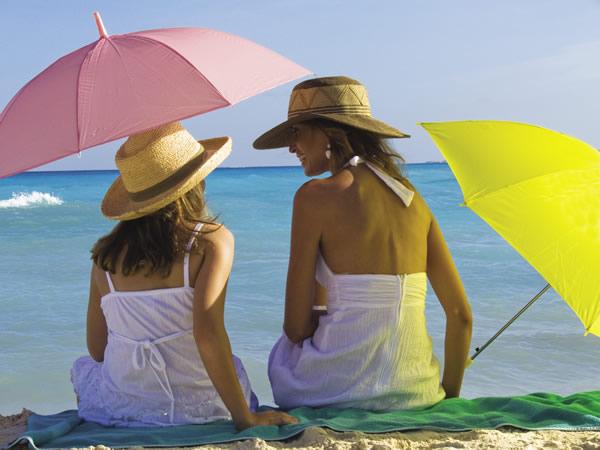 Beachside bonding at Gran Porto Real Resort and; Spa in Playa del Carmen.