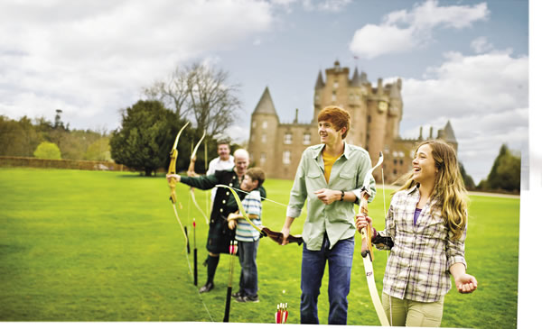 Tour participants try their hand at archery on the grounds of Glamis Castle