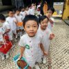 Pre-school children collecting leaves in central Macau.