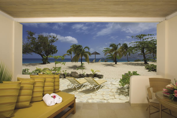 Seagrape Beach Suite at Spice Island Beach in Grenada, whose landscape is made up of native plants.