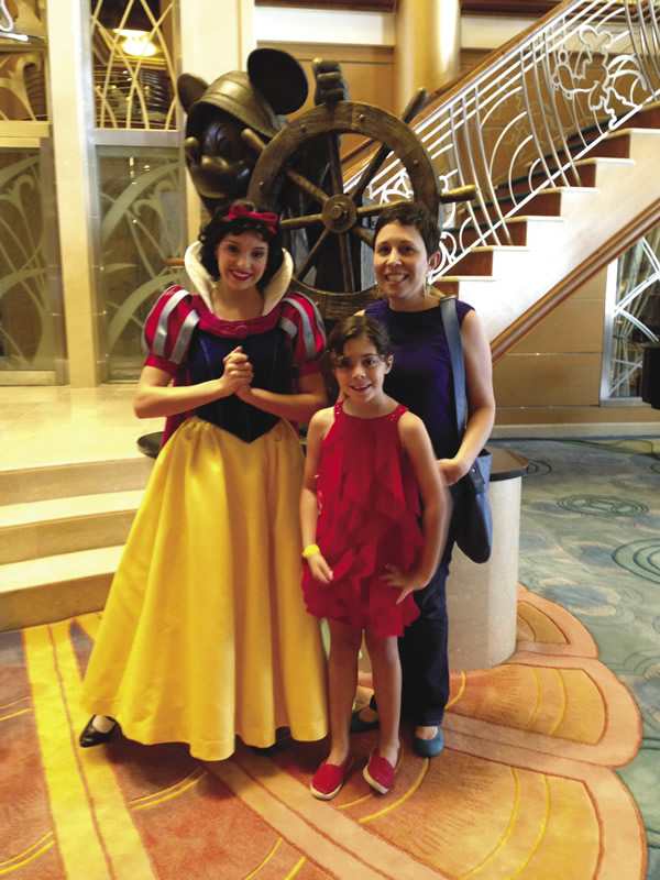 Me and my junior reporter on the Disney Magic.