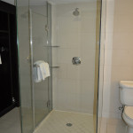 Glass-encased shower is in the center of the bathroom at The Condado Plaza Hilton's Ocean View room.