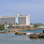 View of Caribe Hilton Hotel from the balcony of The Condado Plaza Hilton's Ocean View room.