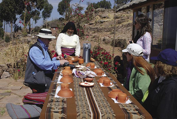 Taquile locals prepare lunch for visitors to the island.