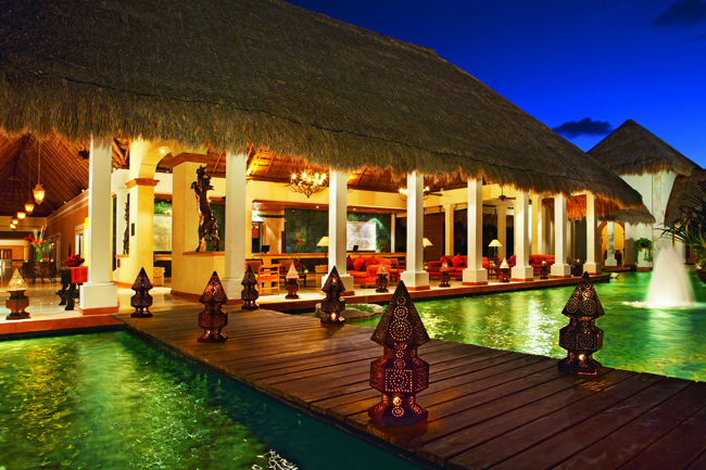 Walkway set atop water leads guest to the open-air lobby. (Photo courtesy of Now Sapphire Riviera Cancun.)