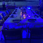 Setting for dinner on the deck of Caribe Hilton Hotel.