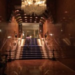 The elegant grand staircase that leads guests to a ballroom at El San Juan Resort & Casino.