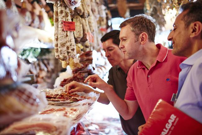 Travelers experience local cuisine.