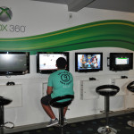 The Xbox game room has walls of game consoles for the teenagers to enjoy.