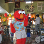Elmo leads the kids in a conga line around the restaurant after the character breakfast.