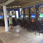 An area with a few slot machines gives gamblers a feel of a casino on the beach.