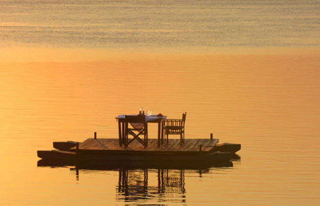 Couples can opt for a floating dinner on the Zambezi River on African Safari Company's tour of the area.