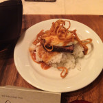 Breakfast of braised beef short ribs served with over-easy egg, white rice, Hamakua Ali'i mushroom sauce and spiced tobacco onions.