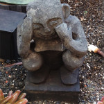 """Statues of Menehune, the """"little people"""" who occupied the islands before the Hawaiians, can be found hidden throughout the resort."""