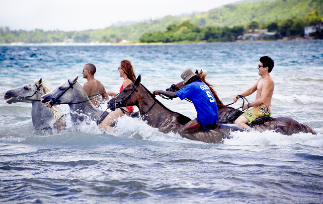 Horseback riding is one of the experiences your clients can enjoy in the Caribbean.