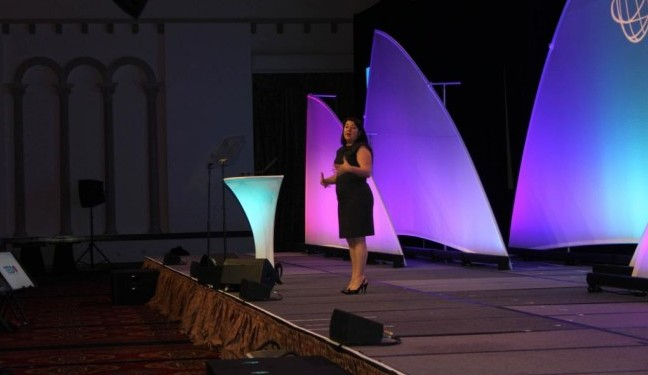 Nicole Mazza, Chief Marketing Officer, American Marketing Group, speaking during the general session at TRAVELMARKET 2014.