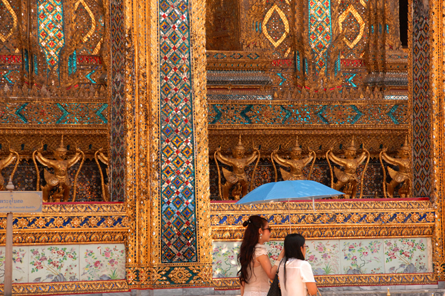 Visitors at the Grand Palace, one of the vibrant city's must-go-to spots, stroll past the Golden Gallery.