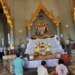 Worshippers at Temple of the Golden Buddha.