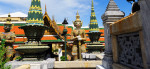 A gate at the Grand Palace is guarded by mythical figures from Hinduism, an early influence on Thai religion.