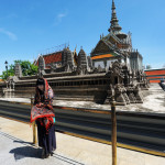 A visitor on the courtyard of the Grand Palace.