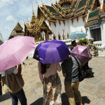 Umbrellas to shield against Thailand's brutal sun and heat are de rigueur when visiting the Grand Palace.
