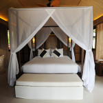 The bedroom in one of The Treasure's 37 villas on Koh Madsum.