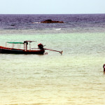Net fisherman in the shallow waters of Koh Samui, traditionally a water sports mecca in Thailand.