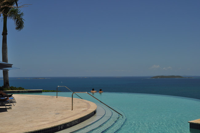 Guests at El Conquistador Resort soaking in the views in the infinity pool at Las Casitas.
