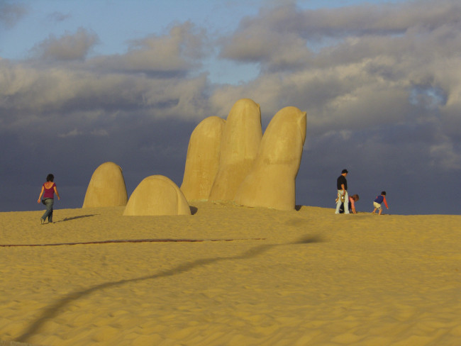 """The Hand in the Sand,"" by Mario Irarrazabal, has become the iconic artwork of Punta del Este, which clients visit on a Latin American Escapes tour."