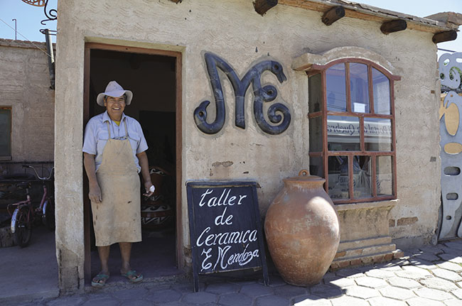 Visitors on Culture Xplorers' Argentina: True North itinerary visit a ceramic workshop.