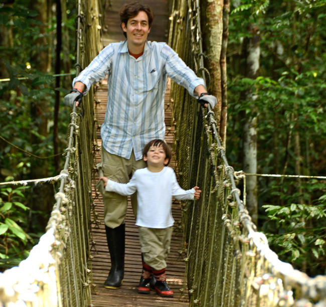 Jim Kane and his son crossing a bridge in (Photo courtesy of Culture Xplorers.)