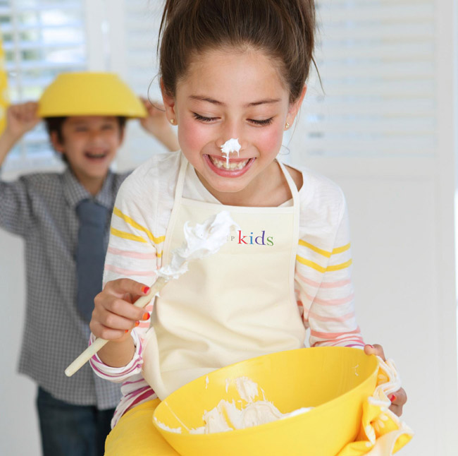 Chefs in training cooking fun for kids at Trump International.