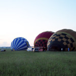 Hot air balloons filling up to take off for a  sunrise tour.
