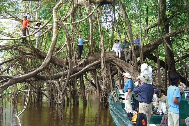 Travelers take a photo op on International Expeditions' (IE) Amazon River tour.